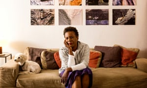 Poet Claudia Rankine and dog Sammy at home.
